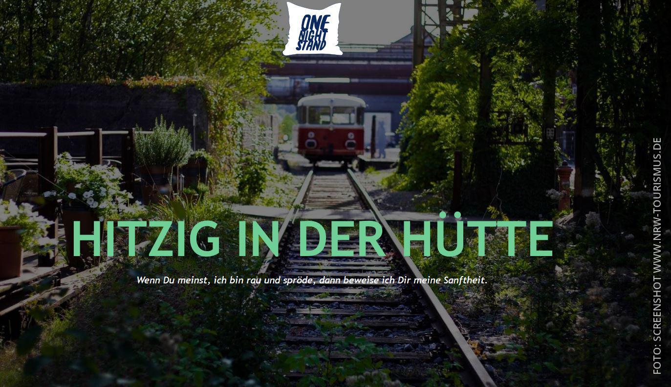 """Ein Werbemotiv mit einem Eisenbahnwagen und dem Spruch """"Hitzig in der Hütte"""""""